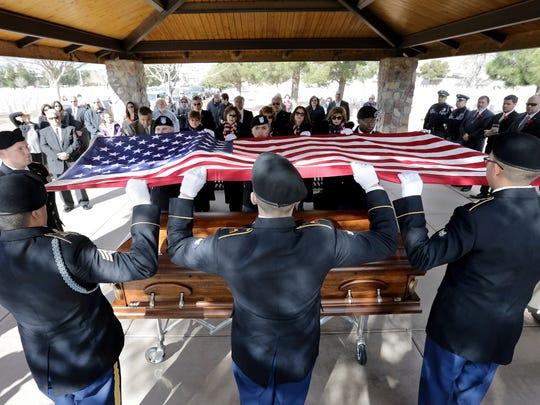 The Fort Bliss honor guard folds Armando Sambrano's