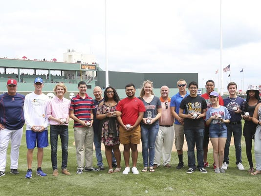 The first 13 recipients of Red Sox Foundation Scholarships awarded in Lee County, Florida are honored in a special pregame ceremony before a spring training Grapefruit League game between the Boston Red Sox and St. Louis Cardinals at JetBlue Park at Fenway