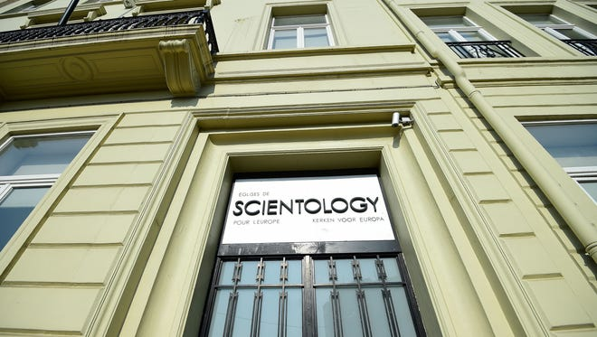 A picture taken on March 11, 2016 shows the entrance of a branch of The Churches of Scientology for Europe in Brussels.   A judge will deliver his verdict on March 11, 2016 on whether the Belgian branch of the controversial Church of Scientology should be banned over fraud and extortion allegations. Eleven members of the church and two affiliated bodies have been charged with fraud, extortion, running a criminal organisation and violating the right to privacy, all of which the US-based church denies.