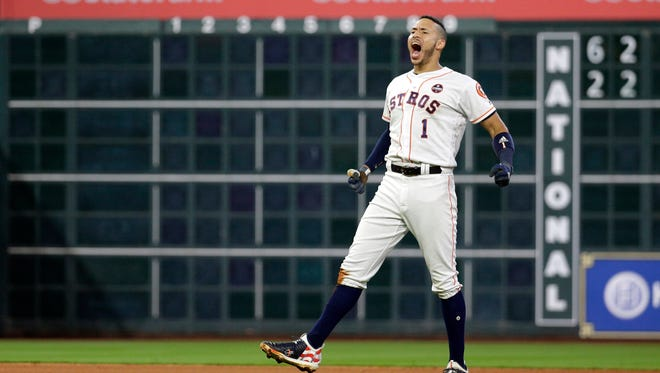 Carlos Correa celebrates after  driving in the game-winning run.
