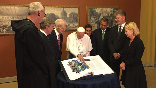 Pope Francis witnesses the official presentation of the Apostles Edition of The St. John's Bible to the Library of Congress. The gift, made possible by GHR Foundation, was chosen to commemorate the visit by Pope Francis to the United States. The participants in the presentation are from left, Abbot John Klassen; Chairman of Joint Committee on the Library, Sen. Roy Blunt; Librarian of Congress James H. Billington; Pope Francis; Speaker of the House John Boehner; St. John's University President Michael Hemesath; and GHR Foundation CEO Amy Rauenhorst Goldman.