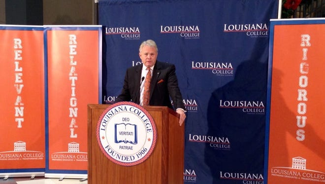 Louisiana College President Rick Brewer announces Tuesday that the private Baptist college in Pineville no longer is on probation with its accrediting agency.