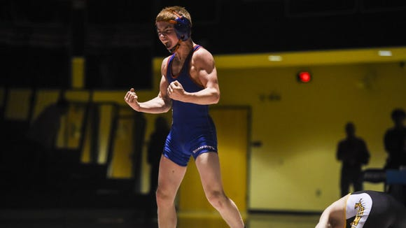 Spring Grove's Dalton Rohrbaugh shouts after a pin against Red Lion's Jacob Frock last season. Rohrbaugh could help Spring Grove contend for the YAIAA Division I team title this season.