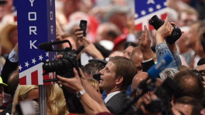 Eric Trump (C), son of Republican presidential candidate Donald Trump, arrives on the floor of the Republican National Convention on July 19, 2016 at Quicken Loans Arena in Cleveland, Ohio.