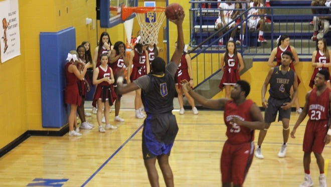 Canton's Javian Fleming goes up for a dunk.