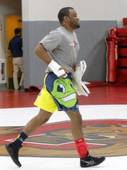 Enock Francois works out with the Cornell University