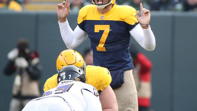 Green Bay Packers quarterback Brett Hundley (7) signals at the line of scrimmage against the Baltimore Ravens on Sunday, Nov. 19, 2017 at Lambeau Field.