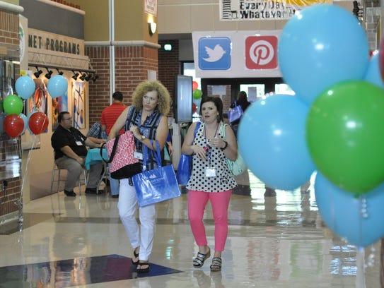 Area educators arrive Monday morning at Peabody Magnet