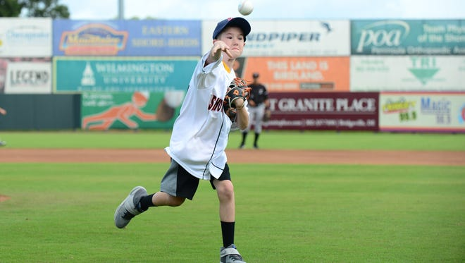Garrett Rogers, rehabilitating from critical injuries that hospitalized him for more than three months, throws out the ceremonial first pitch before the start of the Delmarva Shorebirds on Sunday, Sept. 4,2016.