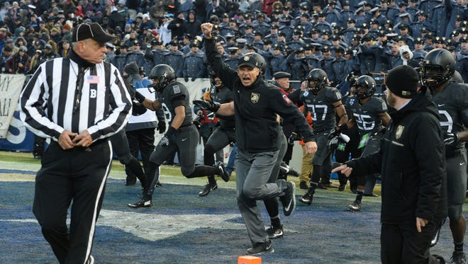 Army's Head Coach Jeff Monken cheers as his team enter the 2nd half of the game with the lead against Navy on Saturday, Dec. 10, 2016 during America's Game in Baltimore, Md.