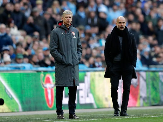 Arsenal manager Arsene Wenger, left, and Manchester City coach Pep Guardiola stand next to each other during the English League Cup final soccer match between Arsenal and Manchester City at Wembley stadium in London, Sunday, Feb. 25, 2018. (AP Photo/Frank Augstein)
