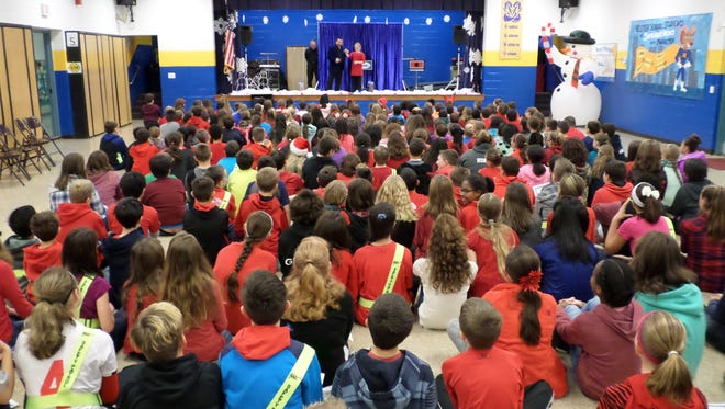 Students who earned All Star status at Caroline L. Reutter School for the first trimester were invited to an assembly featuring a magician.
