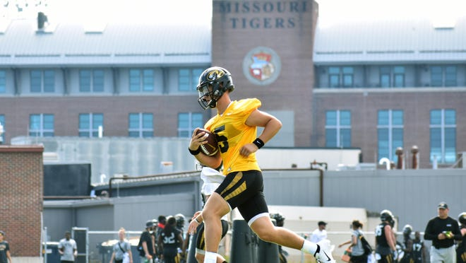 Missouri quarterback Taylor Powell (5) runs with the ball in his hand during a team practice last August at the Kadlec Practice Fields.