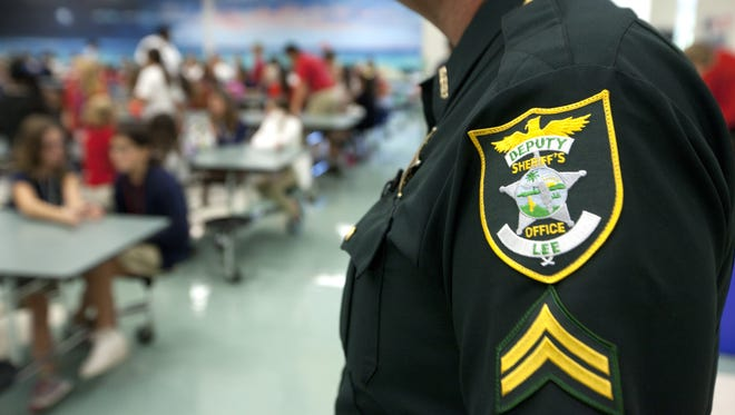Lee County Sheriff's Cpl. Chris Stevens stands guard in 2013 at North Fort Myers Academy of the Arts.