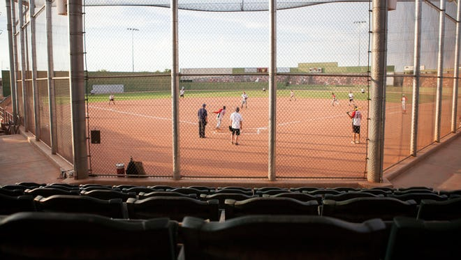 On Thursday, Aug. 14, 2014, baseball games start early in the evening. Big League Dreams sports park in Gilbert is planning to go undergo seating modification and safety repairs starting Aug. 18, 2014.