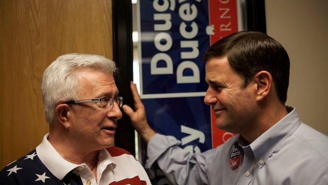 Doug Ducey, former CEO of Cold Stone Creamery, held an ice cream social campaign event with business people on July 2. John Hunsley gets a few words in with Ducey at the event.