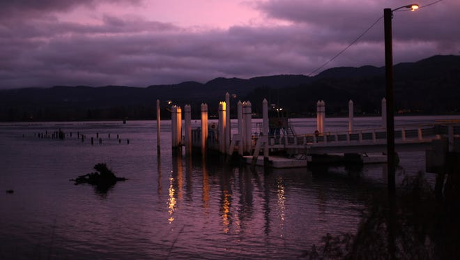 The sun sets on the Westport Ferry on the Columbia River.