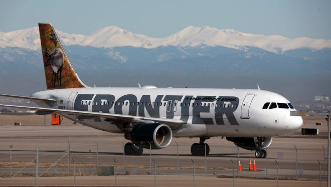 A Frontier Airlines plane arrives at Denver International Airport.