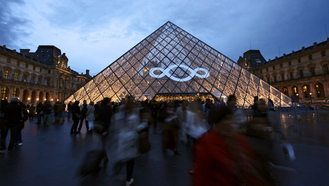 People leave the Louvre Museum after the 2013 European Night of the Museums on May 18, 2013