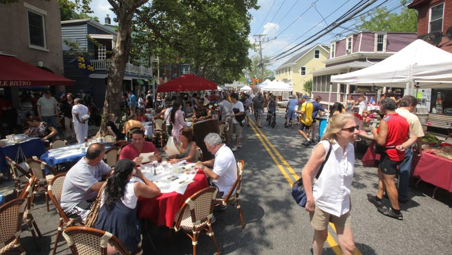 Local residents enjoy Piermont's 2014 Bastille Day Festival with live bands and costume contest.