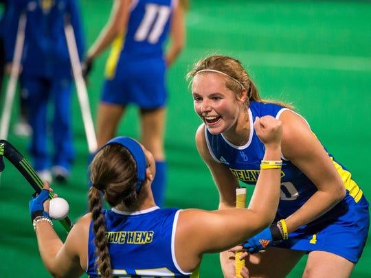 Meghan Winesett left) and Esmee Peet celebrate Delaware's NCAA field hockey semifinal win.