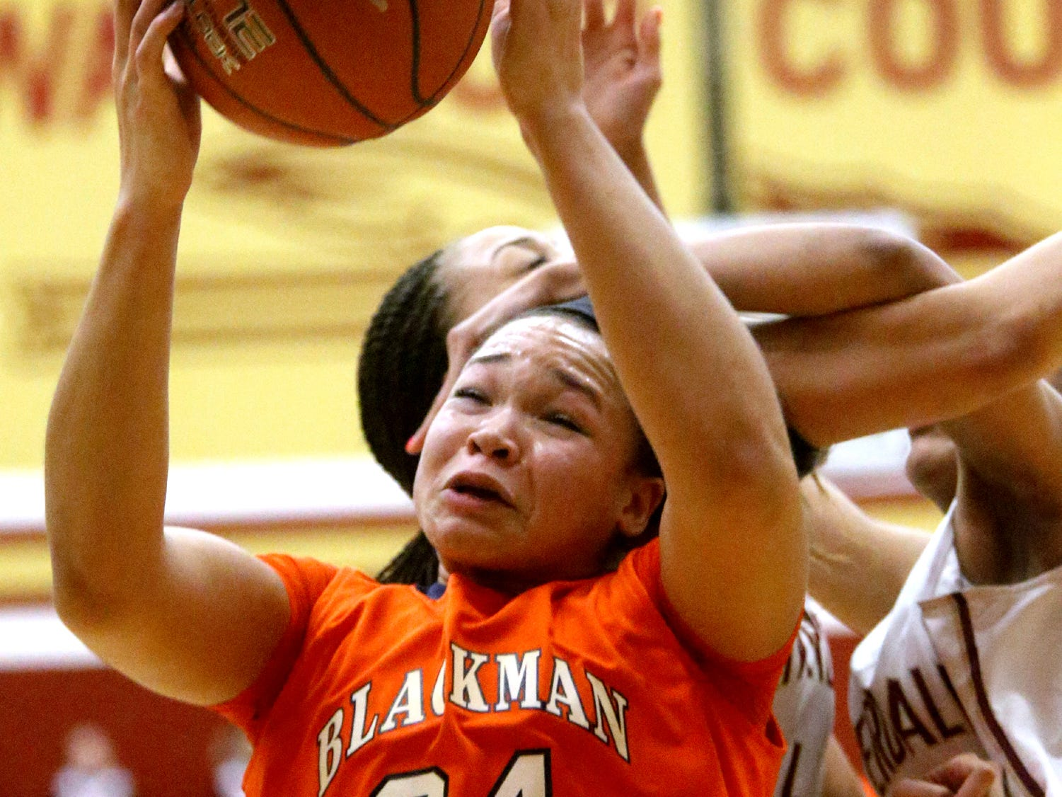 Blackman's Alex Johnson grabs the rebound during the first half of the game against Riverdale at Riverdale on Friday Jan. 9, 2015.