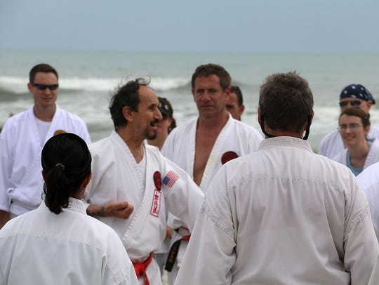 Hanshi Robert Scaglione (red belt) is the CEO of Ueshiro