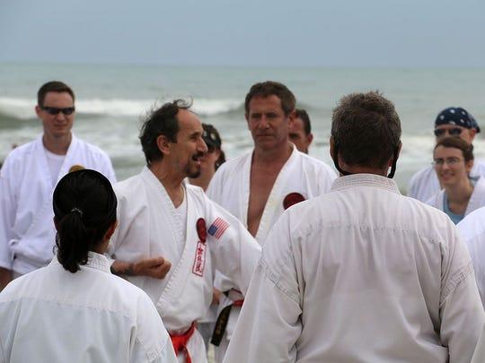Hanshi Robert Scaglione (red belt) is the CEO of Ueshiro