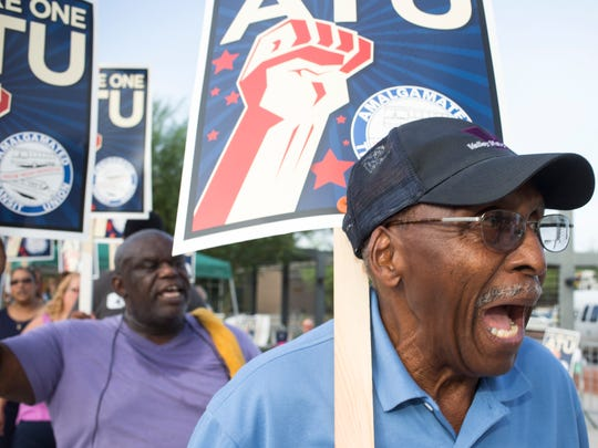 Eddy Smith of Amalgamated Transit Union Local 1433 walks a picket line in Tempe on August 1, 2013.