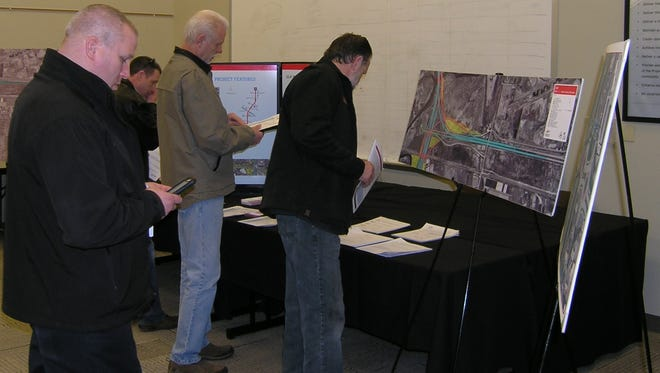 Brian Healey of Woodman's Food Market, left, checks a display Tuesday at the state Department of Transportation U.S. 41 Brown County Project Office. DOT officials updated area businesses and residents on construction plans for the Velp Avenue area.