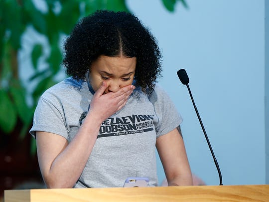 JaKaila Green pauses as she speaks at a vigil held to honor the students killed at Marjory Stoneman Douglas High School in Parkland, Florida, and to stand against gun violence Sunday, Feb. 25, 2018, at the Tennessee Valley Unitarian Universalist Church in Knoxville, Tenn.