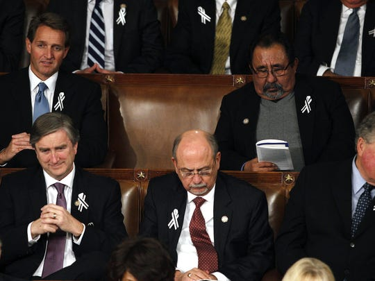 Then-Rep. Jeff Flake and Rep. Raul Grijalva sat together