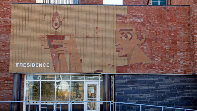 """Stanley Hess' mural """"Passing the Torch"""" graces the Riverfront YMCA above the facility's north entrance."""