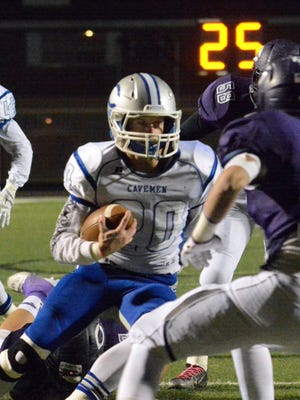 Cavemen senior running back Luke Wood cuts left and scores on a 24-yard touchdown run in the first quarter Friday at Clovis.