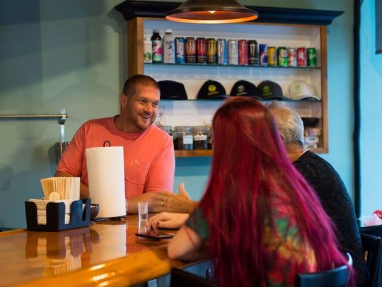 Stuart's Island Root Kava Bar owner John Shealey (left)