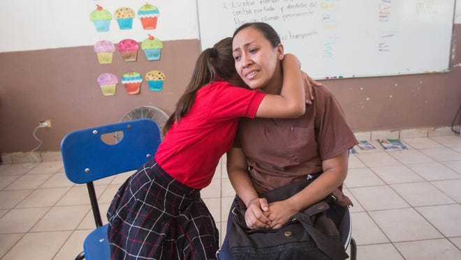 Elizabeth Rossil, 11, hugs her mother, Berenice Aguilar, as her mother begins to cry. Rossil's mother was deported and she opted to be with her mother in Mexico rather than live separated in the U.S.