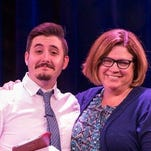 UCF alumnus Alexander Hehr (left) receives the Planet Earth Arts award from Jeanette Farr-Harkins, the National Playwriting Program Chair for the American College Theatre Festival at the Kennedy Center in Washington, D.C. on April 16.