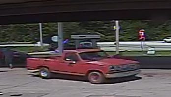 This image released by the South Carolina Highway Patrol shows a red, older model Ford pickup truck.