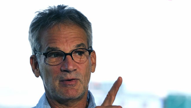 """FILE - In this Sept. 17, 2014 file photo, Colorado-based author Jon Krakauer gestures during an interview in Denver. Krakauer doesn't plan a book tour to promote his latest work, """"Missoula: Rape and the Justice System in a College Town.""""  But he does plan one public appearance in Missoula, where he'll face angry critics who say his portrayal of the small town is unfair. (AP Photo/Brennan Linsley, File)"""
