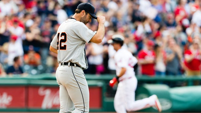 Justin Verlander of the Detroit Tigers reacts as Lonnie Chisenhall of the Cleveland Indians rounds the bases after hitting a two-run home run during the third inning.