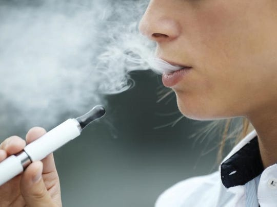 A young person vaping.