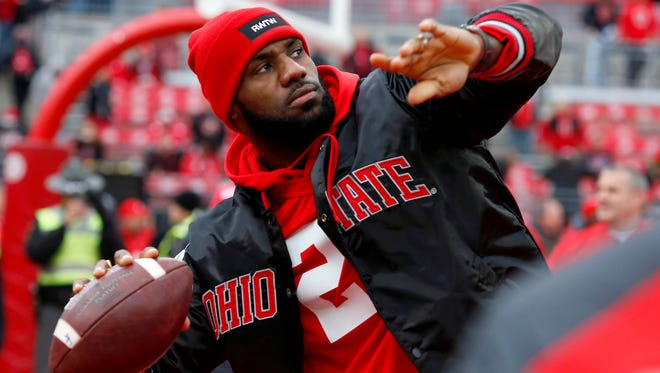LeBron James throws passes inside Ohio Stadium before Saturday's game. James and all of the Cleveland Cavaliers were guests of the Buckeyes.