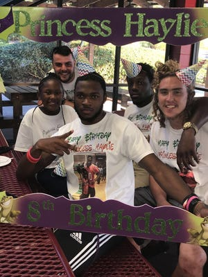 Member's of FAMU's football team surprised Florida High student Haylie Grant at Fun Station for her birthday.