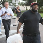 Thomas Edison, and Terrance Irons, who were arrested for the shooting of 5-year-old Andrew Faust Jr., leave the Lee County Jail after their release on Tuesday.