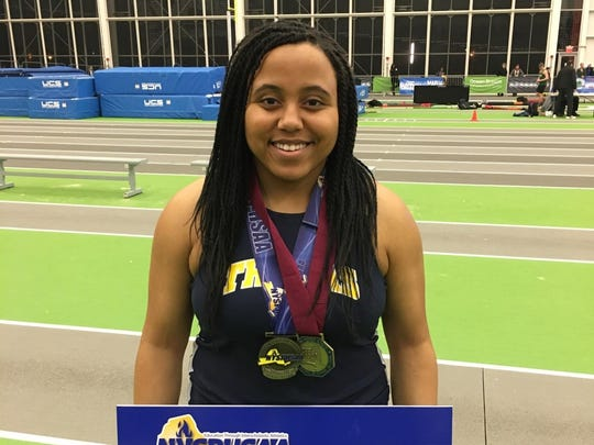 Webster Thomas's Monique Hardy after she wins the state championship in the weight throw.