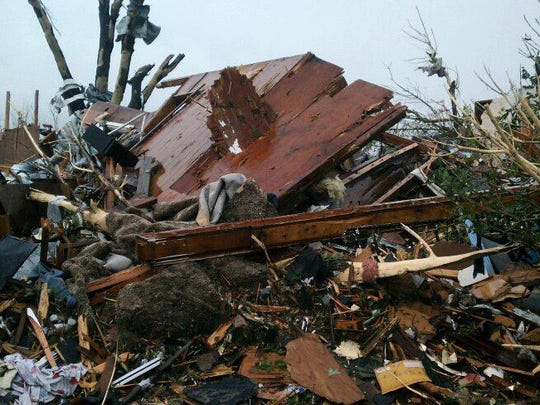 A cell phone photo from Thomas Hardin of the house where his mom was when the tornado hit Joplin on May 22, 2011.