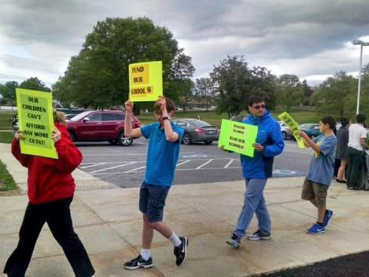 Parents and students protest outside of the Shippensburg school board meeting on Wednesday, May 13. Board members were discussing staff cuts to help cut a budget deficit. (Sarah Davis/Public Opinion)