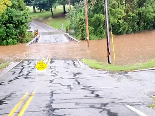 Baker Road was flooded near Hadley Drive at the Dover and West Manchester township line on Thursday.