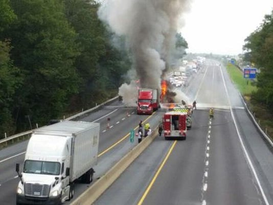 Firefighters battle a tractor-trailer fire on Interstate 78 in Upper Bern Township on Tuesday.