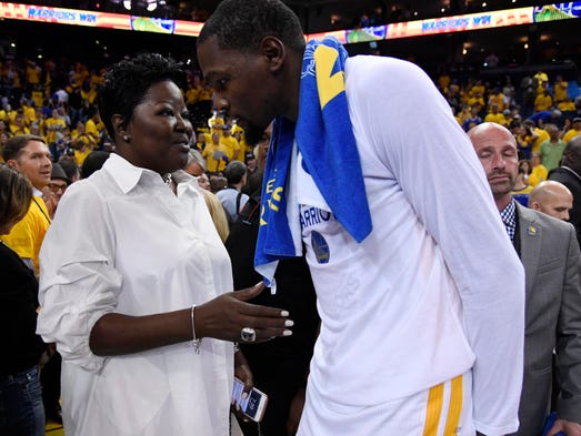 Kevin Durant greets his mother Wanda after Game 2.